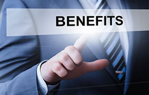 Businessman with his finger on the word BENEFITS