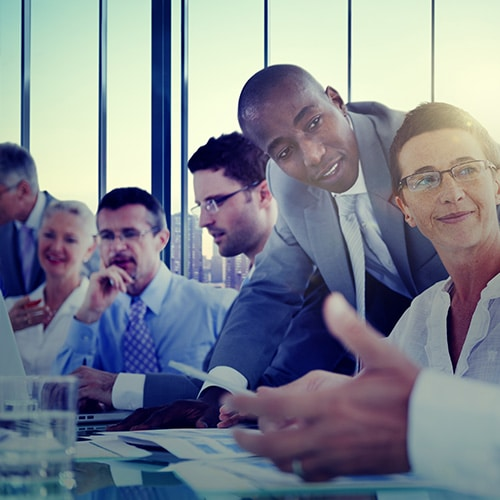 Employees in a group meeting - Benefit Strategies Inc