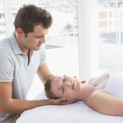 Massage therapist working with a patient.