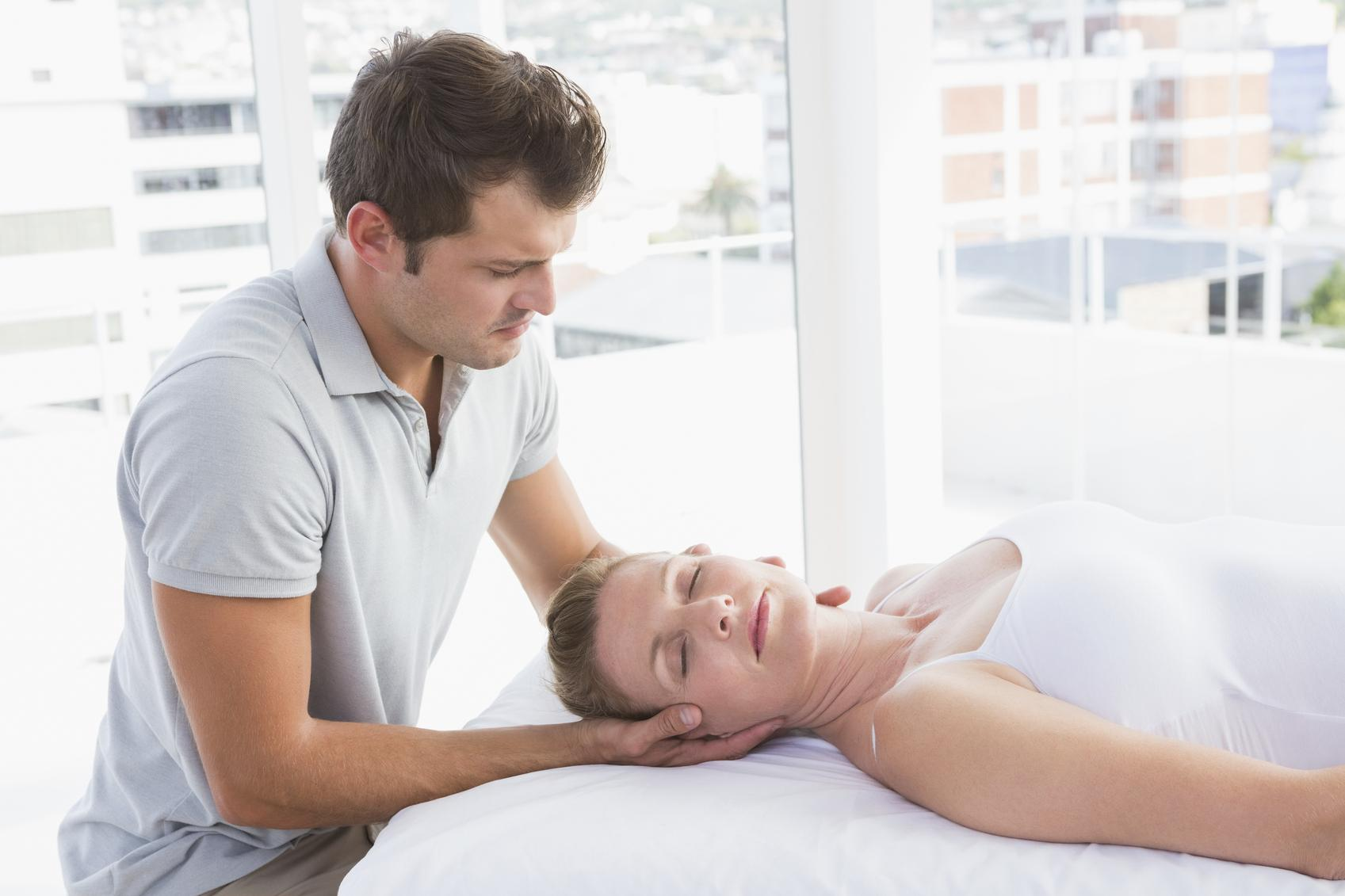 Massage therapist working with a patient - Benefit Strategies Inc