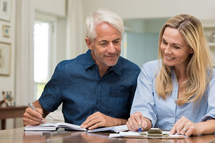 Older couple engaged in retirement planning - Benefit Strategies Inc