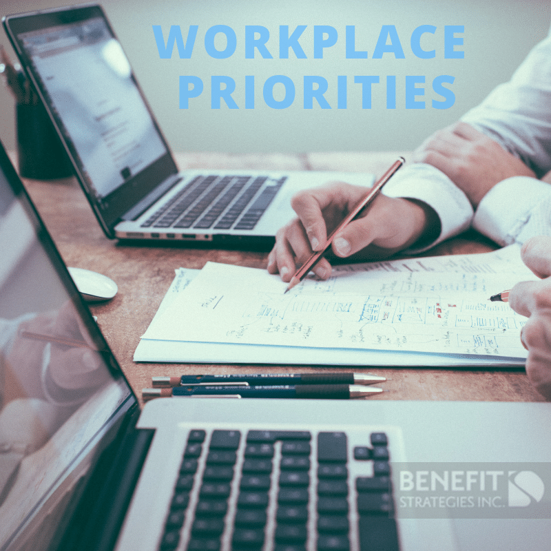 Personnel at a desk with Laptops - Benefit Strategies Inc