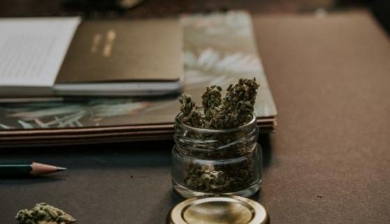 Bottle on a desk with Legalized Marijuana.