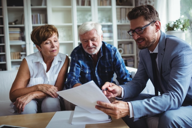 Young professional discussing insurance with older couple