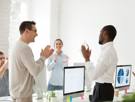 Young professionals clapping after a presentation